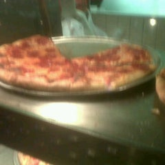 Photo taken at Metro Pizza by Andrea A. on 9/18/2011