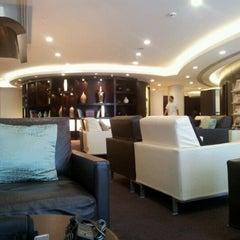 Photo taken at Etihad Airways Lounge by Darren R. on 6/26/2012