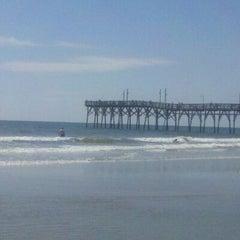 Photo taken at Sunset Beach by Tara K. on 4/14/2012
