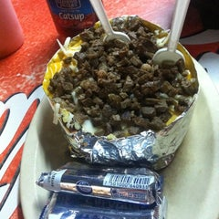 Photo taken at Mackoy's Burger & Papas by Claudia T. on 9/8/2012