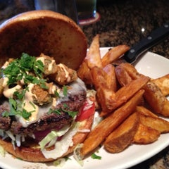 Photo taken at BJ's Restaurant and Brewhouse by C.J. P. on 7/22/2012
