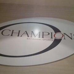 Photo taken at Champions Sports Bar by Derek A. on 5/10/2014