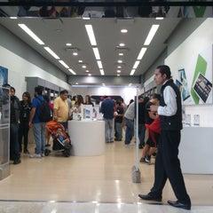 Photo taken at iShop by Rafael G. on 11/14/2014