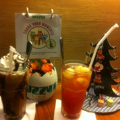 Photo taken at Nuzzy's Mousse and Resto by X'tine Y. on 12/16/2011