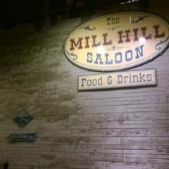 Photo taken at Mill Hill Saloon by Amy M. on 12/7/2014