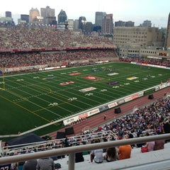 Photo taken at Stade Percival-Molson Memorial Stadium by Jonathan N. on 7/4/2013