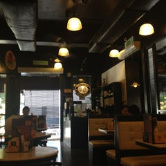 Photo taken at OldTown White Coffee by Sam L. on 7/2/2013