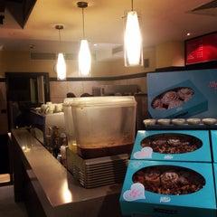 Photo taken at Cinnabon Bakery Cafe by Ahmad I. on 5/8/2014
