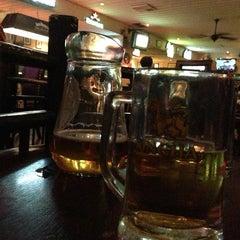 Photo taken at Mulligan's Irish Bar by Parit L. on 3/24/2013