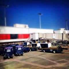 Photo taken at Gate T12 by Jessica L. on 3/30/2014