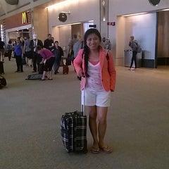 Photo taken at Gate 12 by Debora on 8/7/2013