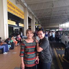 Photo taken at Gate T5 by Aida Haron DGooi on 4/18/2014