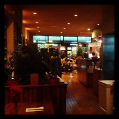 Photo taken at Wild Ginger Pan-Asian Vegan Cafe by Paula R. on 9/30/2012