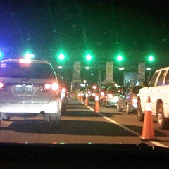 Photo taken at NLEx Bocaue Toll Plaza by John Paul G. on 11/3/2012