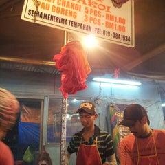 Photo taken at Pasar Malam Desa Tasik (Night Market) by Fiverules A. on 6/12/2013