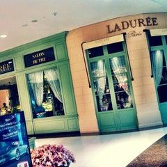 Photo taken at Ladurée لادوريه by Pacharapun T. on 1/23/2013