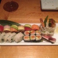 Photo taken at Sushi Taro by Lisa B. on 7/6/2013