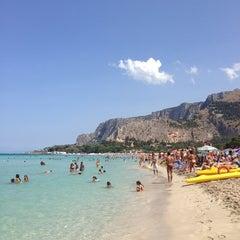 Photo taken at Spiaggia di Mondello by Evgeniya W. on 6/28/2013