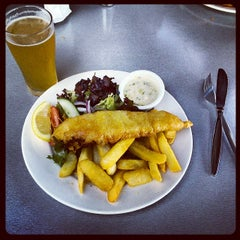 Photo taken at The Wharf Shed Café by Martin K. on 2/3/2014