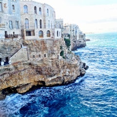 Photo taken at Grotta Palazzese by Alecia R. on 9/29/2015