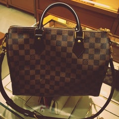 Photo taken at Louis Vuitton by Voury B. on 8/19/2013