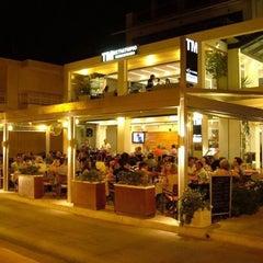 Photo taken at TM restaurant cafe by Γιαννης Ε. on 8/11/2013