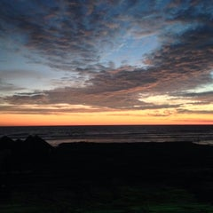 Photo taken at Playa Bonfil by Carlos F. on 12/28/2013