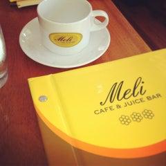 Photo taken at Meli Cafe & Juice Bar by Pamela Y. on 7/4/2013