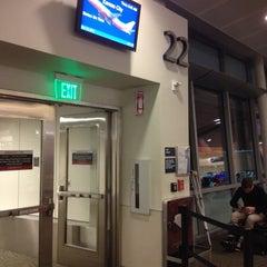 Photo taken at Gate 22 by Jon S. on 12/14/2013