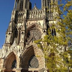 Photo taken at Cathédrale Notre-Dame de Reims by Mimi S. on 6/4/2013