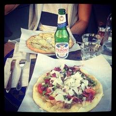Photo taken at Pizzetta 211 by Scott W. on 10/1/2012