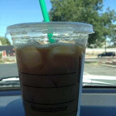 Photo taken at Starbucks by Tiffany E. on 8/11/2013
