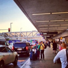 Photo taken at Terminal 5 by Jon W. on 12/15/2012