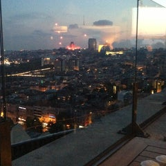 Photo taken at Conrad Roof Bar by Alex P. on 6/8/2013