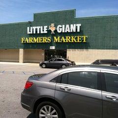 Photo taken at Little Giant Farmer's Market by Desmond R. on 5/25/2013