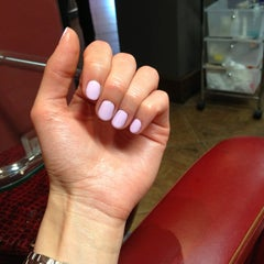 Photo taken at Express Nails by Vera T. on 6/19/2013