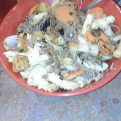 Photo taken at Genghis Grill by Bradley L. on 1/14/2013
