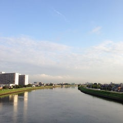 Photo taken at 飯塚橋 by 栄光 工. on 7/1/2013