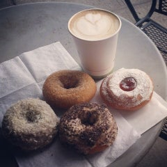 Photo taken at Mighty-O Donuts by Alanna G. on 8/14/2013