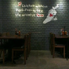 Photo taken at Nando's by Mohd R. on 6/20/2013