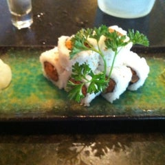 Photo taken at Rise Sushi Lounge by Laura G. on 4/21/2012