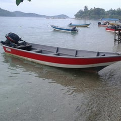 Photo taken at Watercolours Resort & Dive Centre by FahMi R. on 5/17/2014