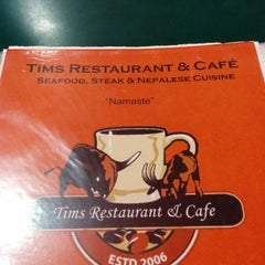 Photo taken at Tims Restaurant & Cafe by Ling on 12/3/2014