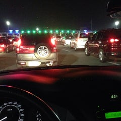 Photo taken at NLEx Bocaue Toll Plaza by Bennie S. on 11/3/2013