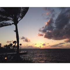Photo taken at Sundowners by Katie L. on 3/7/2014