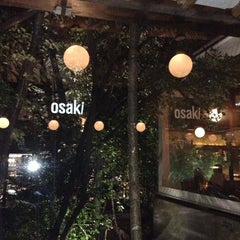 Photo taken at Osaki by Erika M. on 5/12/2013