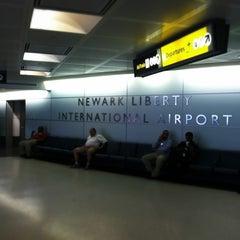 Photo taken at Newark Liberty International Airport (EWR) by Alexander B. on 7/4/2013