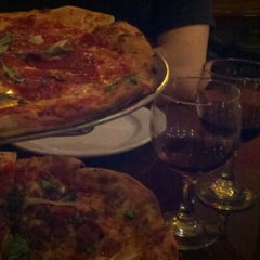 Photo taken at Bollini's Pizzeria Napolitana by Karen T. on 12/31/2011