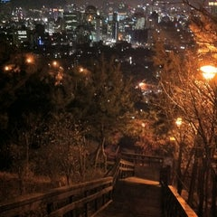 Photo taken at Naksan Park by Song S. on 10/30/2011