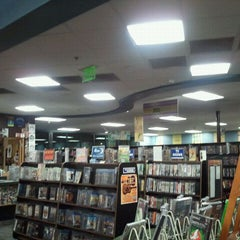 Photo taken at Bookmans by Nomadic J. on 4/10/2011